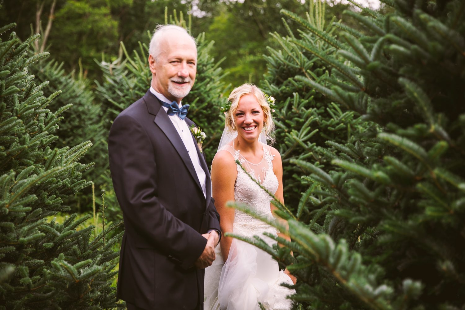 Father Daughter in the Evergreens Sawyer Family Farmstead Cashiers NC Wedding Photographers