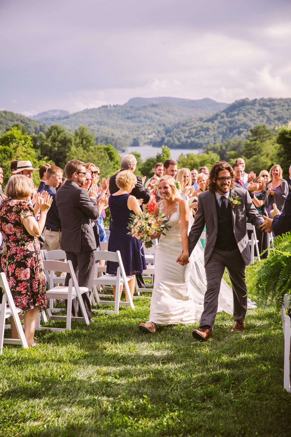 Ceremony Exit Sawyer Family Farmstead Cashiers NC Wedding Photographers