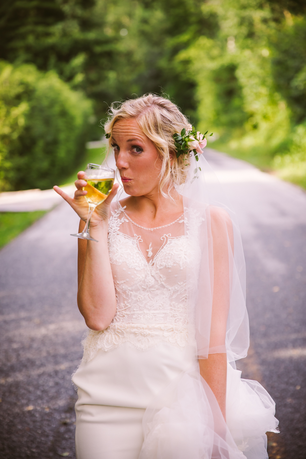 Bride with Wine Sawyer Family Farmstead Cashiers NC Wedding Photographers