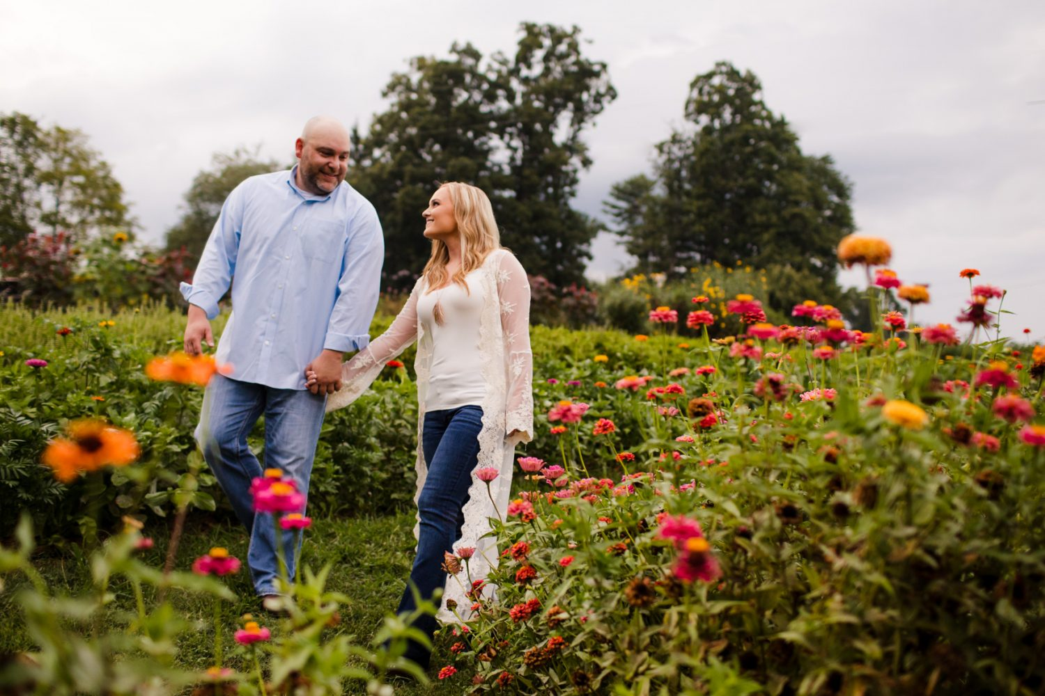 Engagement Portrait Session Walking Through the Garden The Farm - A Gathering Place Candler NC Wedding Photography