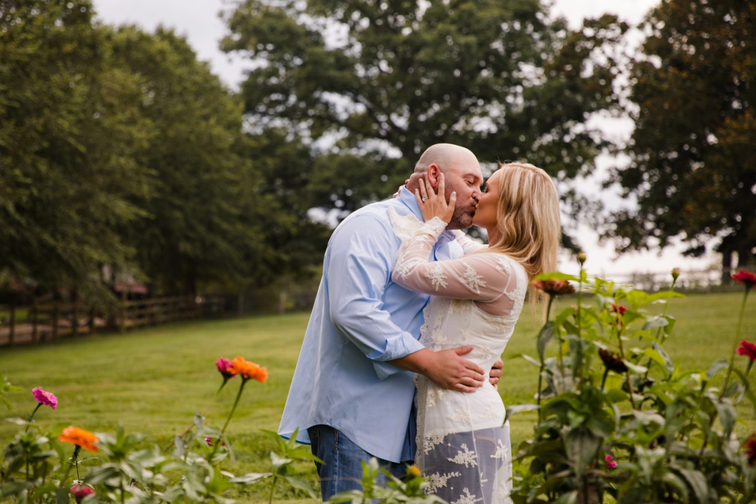 Engagement Session Kisses in the Garden The Farm - A Gathering Place Candler NC Wedding Photography
