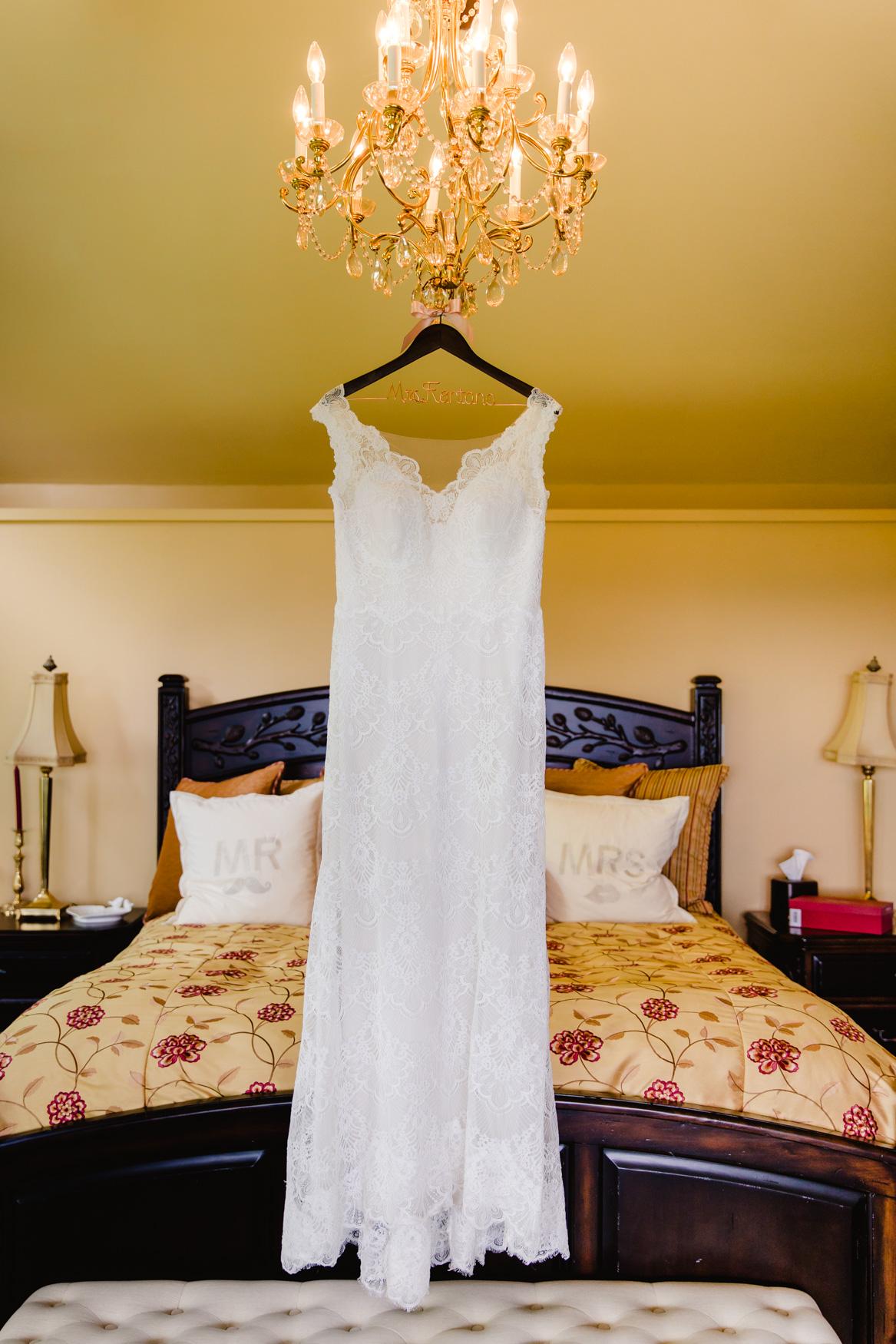 Wedding Dress Hanging From Chandelier Waynesville NC Wedding Photographers