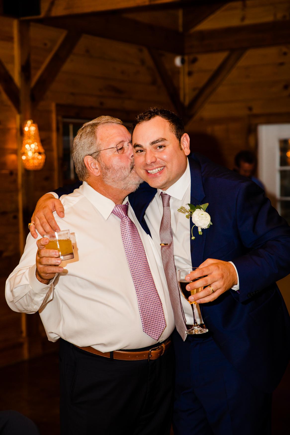 Father-Son Kisses Waynesville NC Wedding Photographers