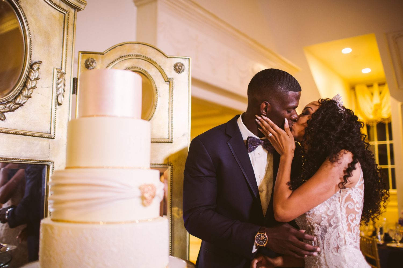 Waynesville Wedding Photography | Cake Cutting Kiss