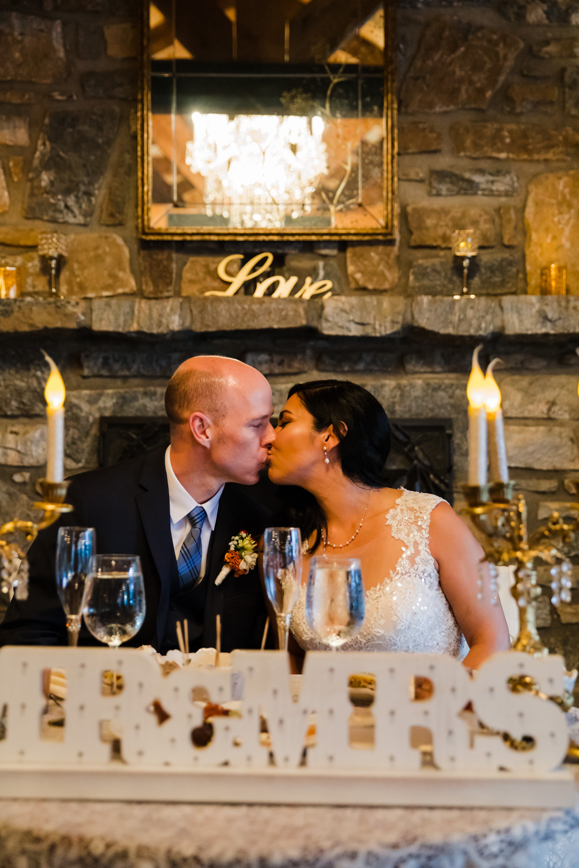 Bride and Groom Kissing at Sweetheart Table Waynesville NC Wedding Photography Inn at Tranquility Farm