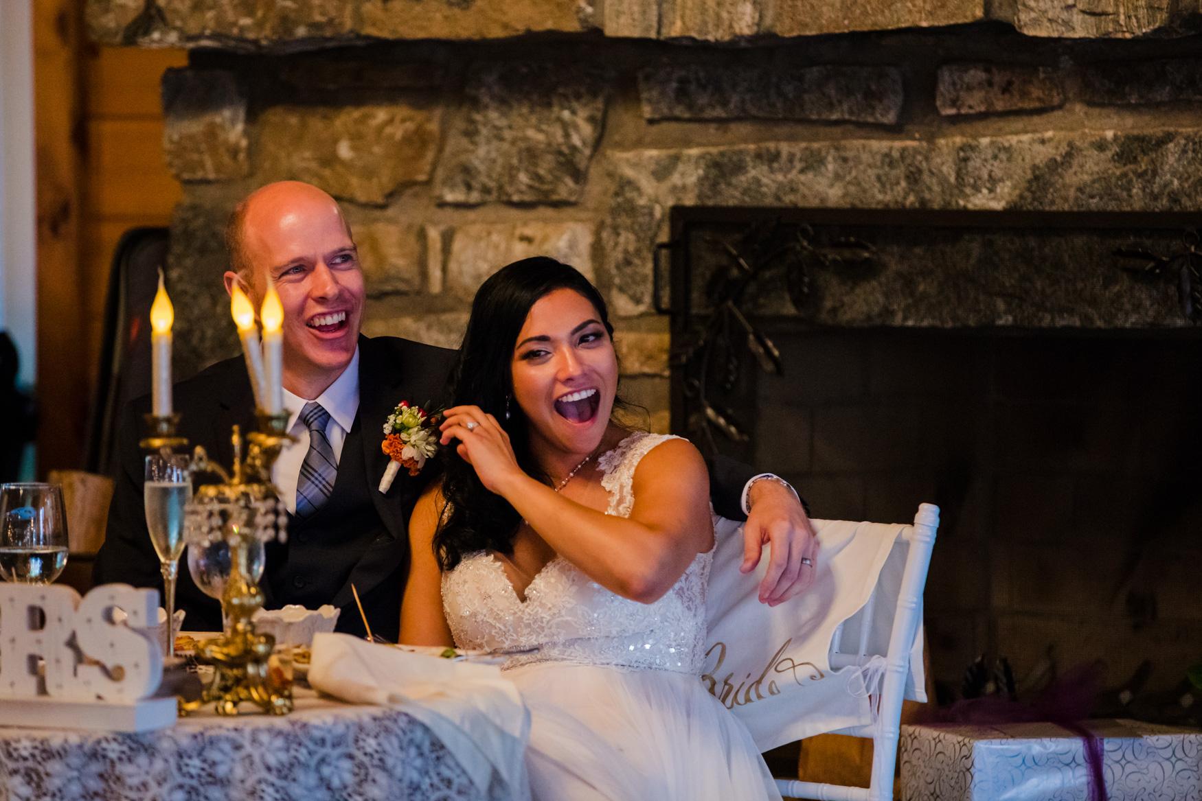 Bride Laughing at Toast Waynesville NC Wedding Photography Inn at Tranquility Farm