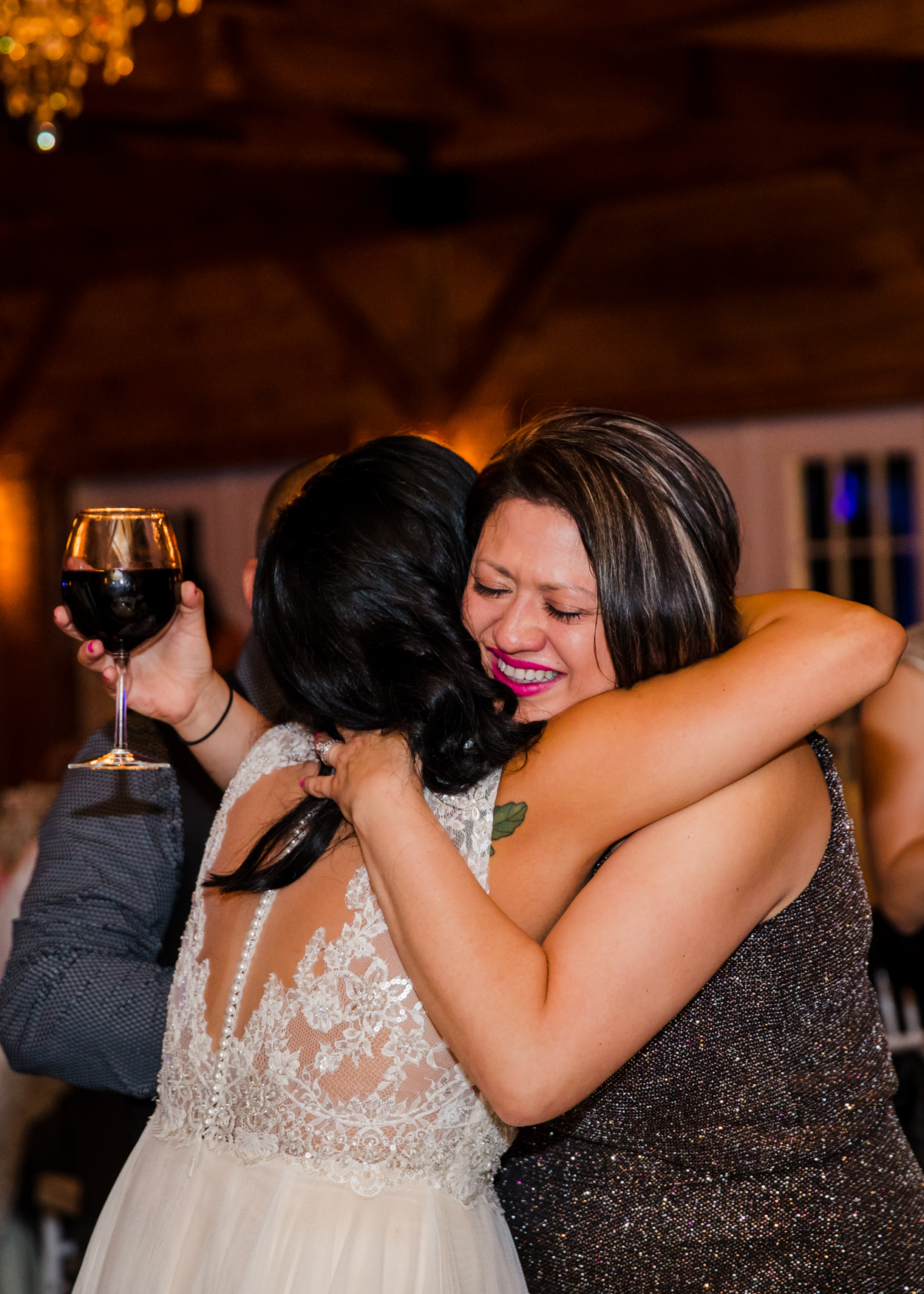 Bride Hugging Guest Waynesville NC Wedding Photography Inn at Tranquility Farm
