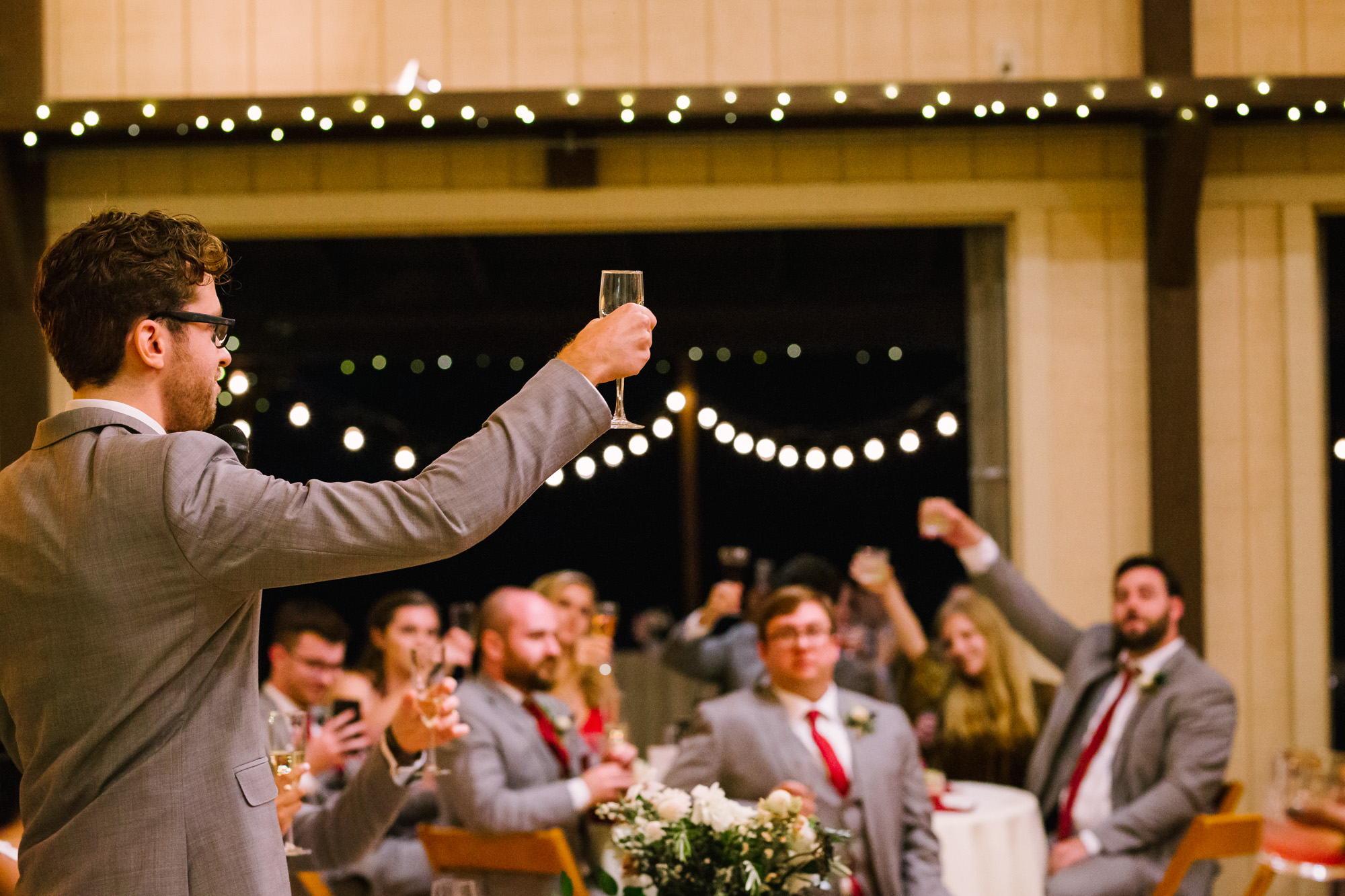 Waynesville NC Wedding Photography | Best Man Lifts Champagne Glass during Toast