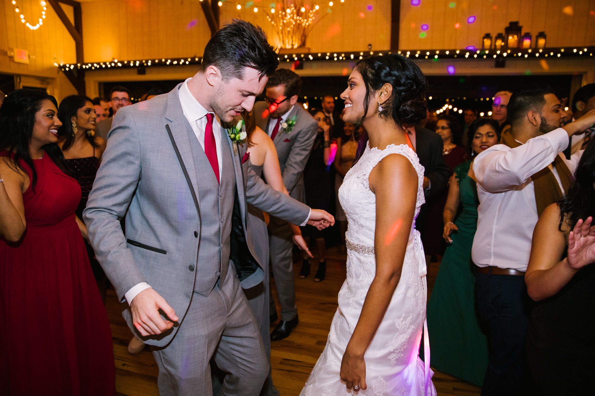 Waynesville NC Wedding Photography | Bride and Groom Dancing with guests under Party Lights