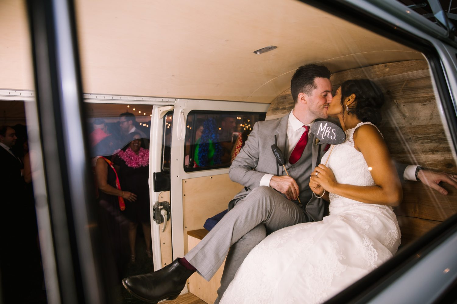 Waynesville NC Wedding Photography | Bride and Groom Kissing in the Photo Booth