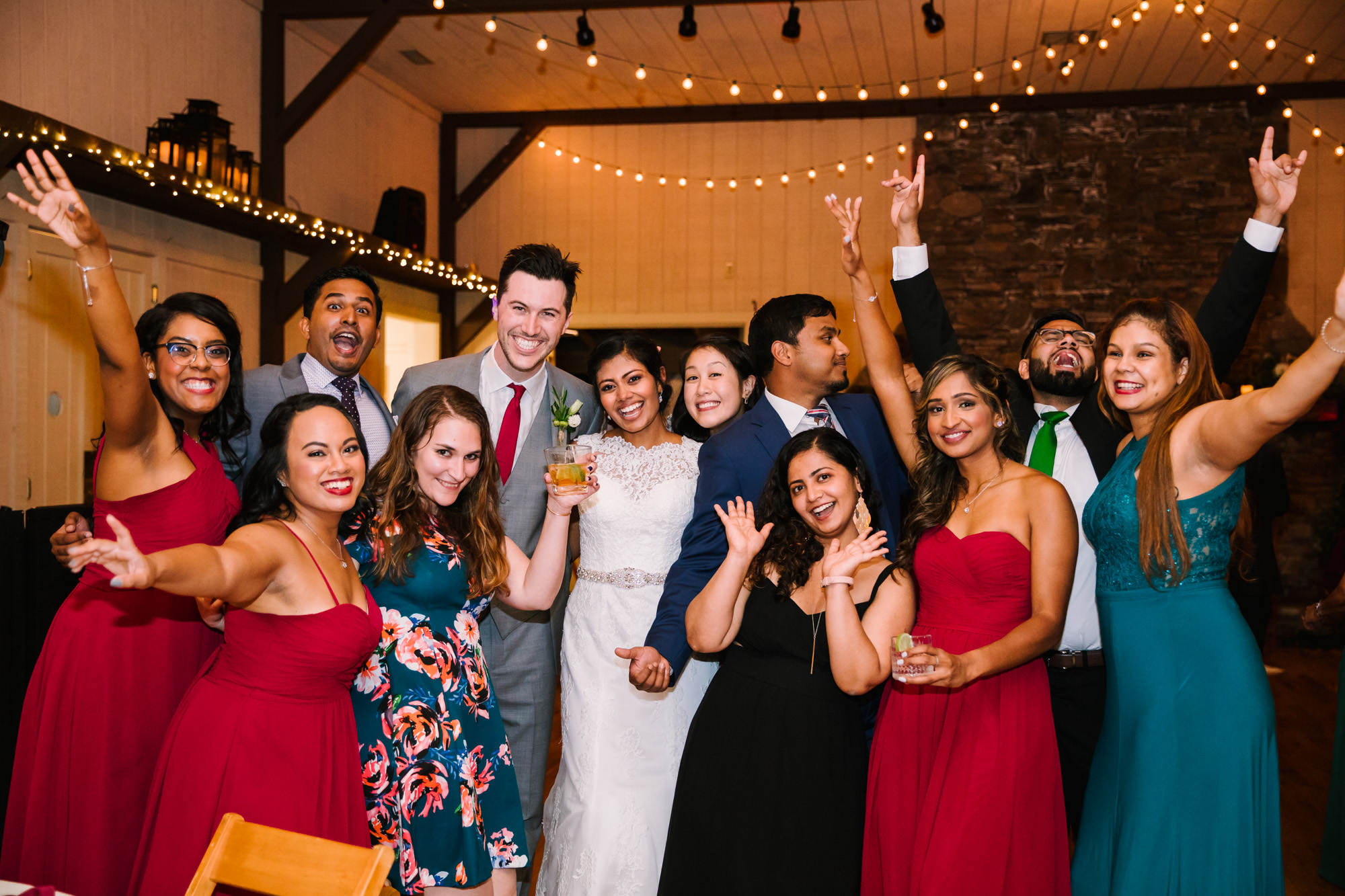 Waynesville NC Wedding Photography | Bride and Groom Pose with Guests on the Dance floor