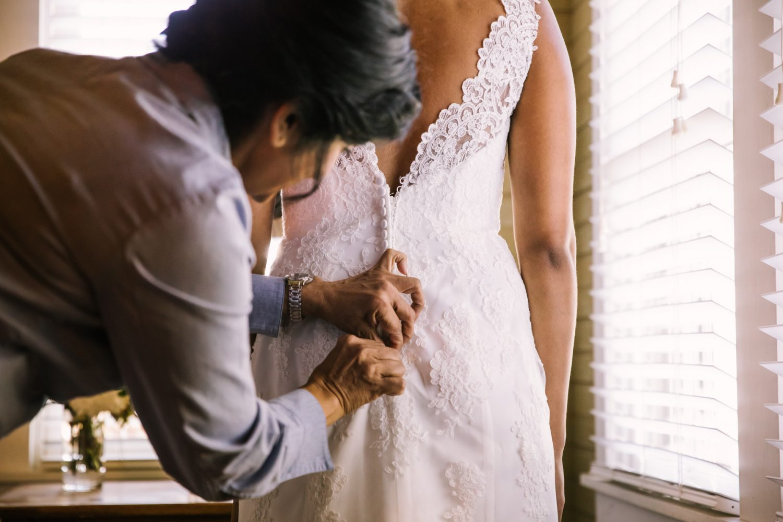Waynesville NC Wedding Photography | Bride's mom buttoning dress