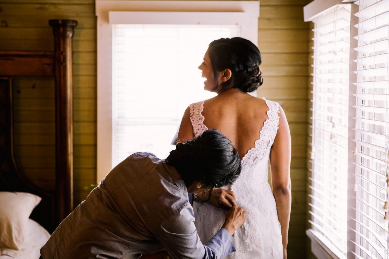 Waynesville NC Wedding Photography | Bride's mom helps her get dressed