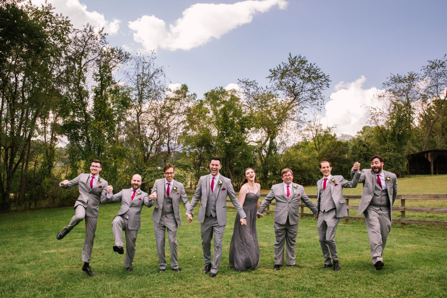 Waynesville NC Wedding Photography | Groomsmen Laughing and Frolicking in the Field