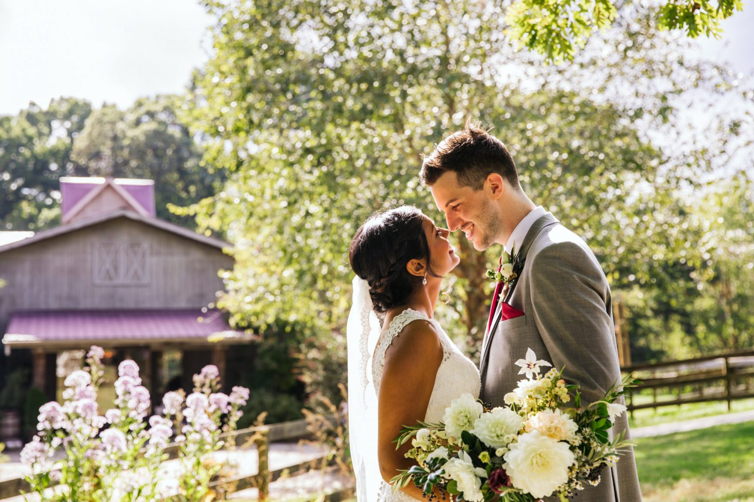 Waynesville NC Wedding Photography | Bride and Groom in front of Wedding Venue