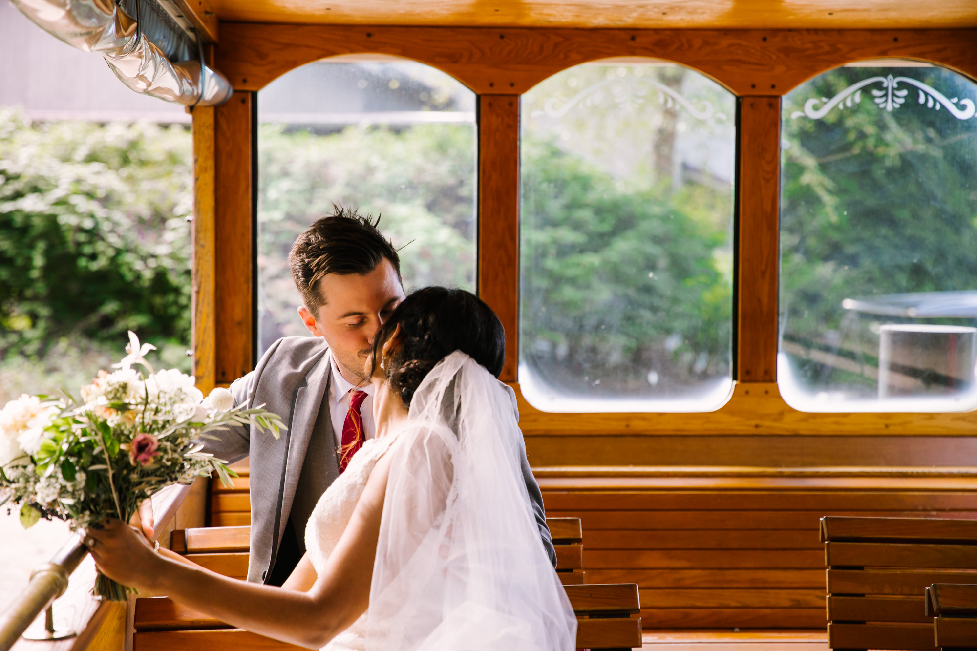 Waynesville NC Wedding Photography | Bride and Groom Kissing on the Trolly