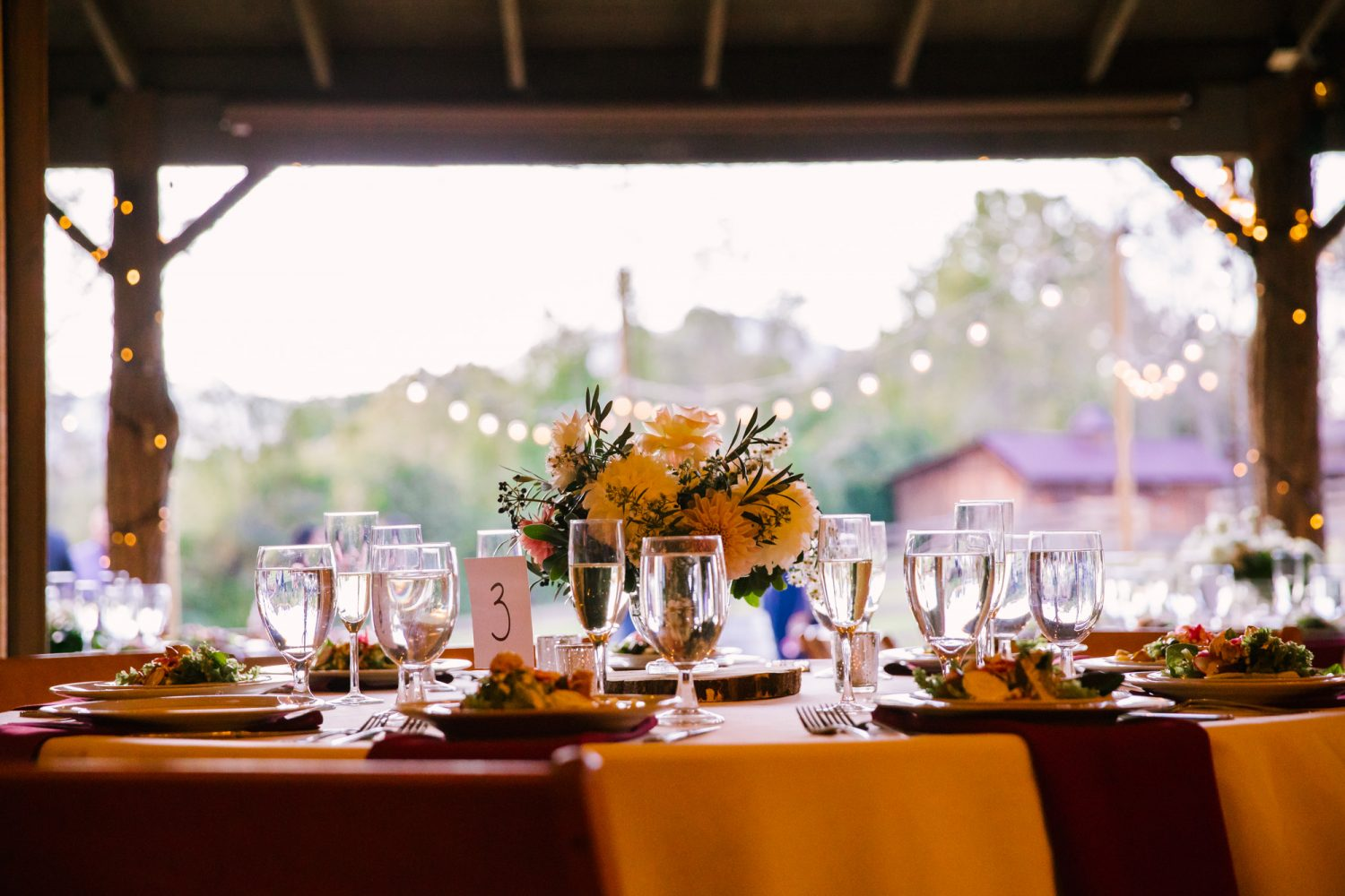 Waynesville NC Wedding Photography | Table Setting with Cafe Lights in the Background