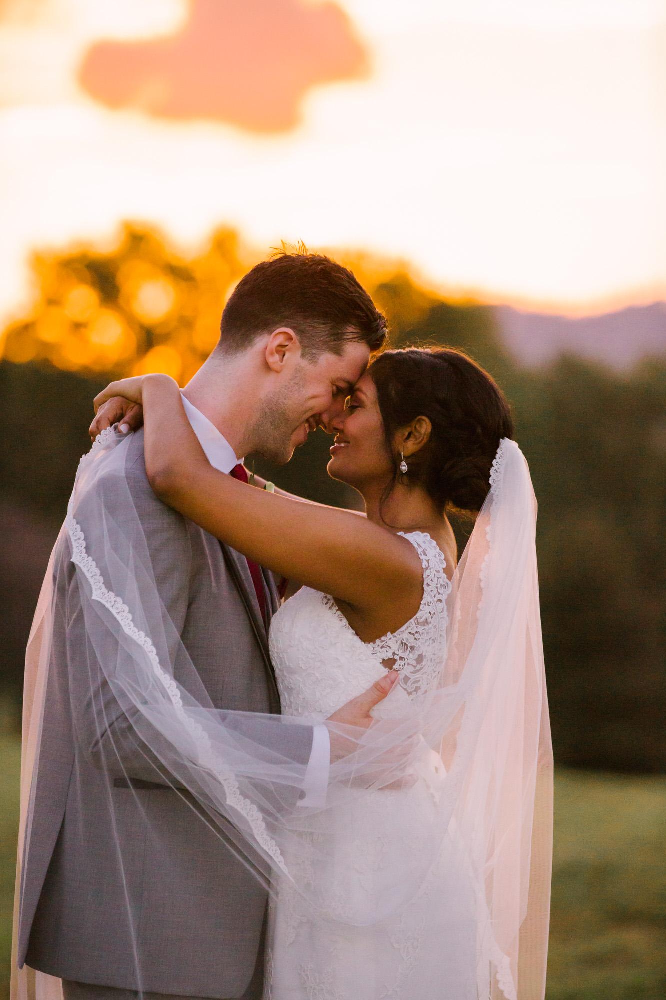 Waynesville NC Wedding Photography | Bride and Groom Hugging at Sunset
