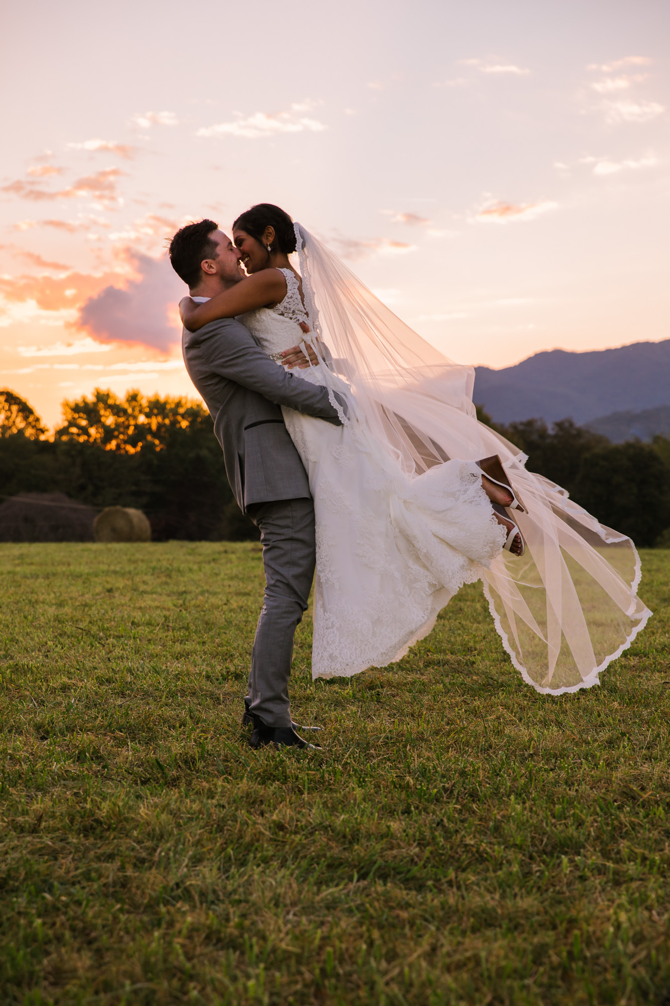 Waynesville NC Wedding Photography | Groom Lifting Bride in the Air at Sunset
