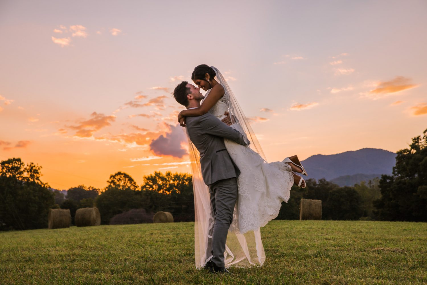Waynesville NC Wedding Photography | Bride and Groom in the Field at Sunset