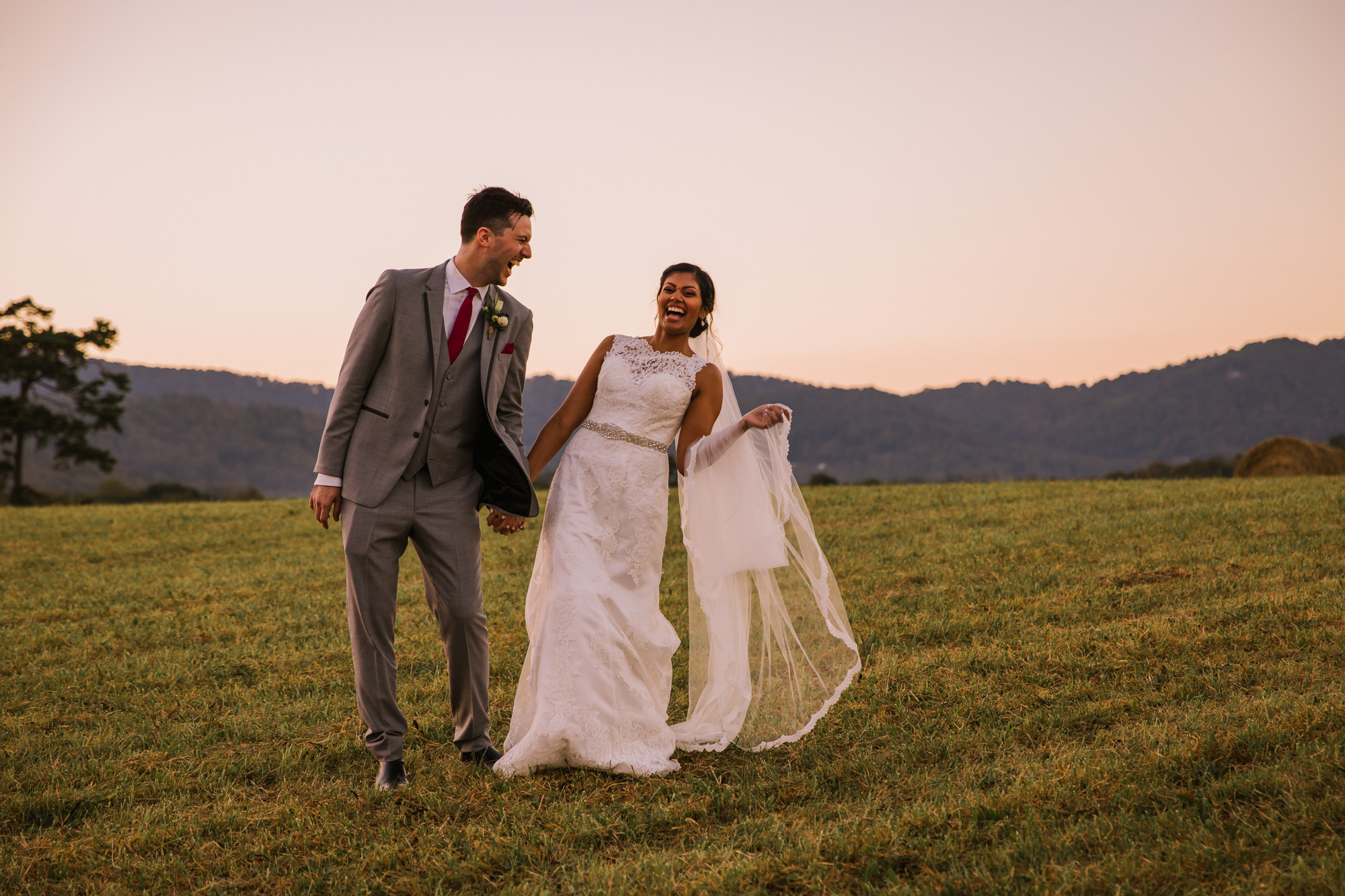 Waynesville NC Wedding Photography | Bride and Groom Laughing in the Field