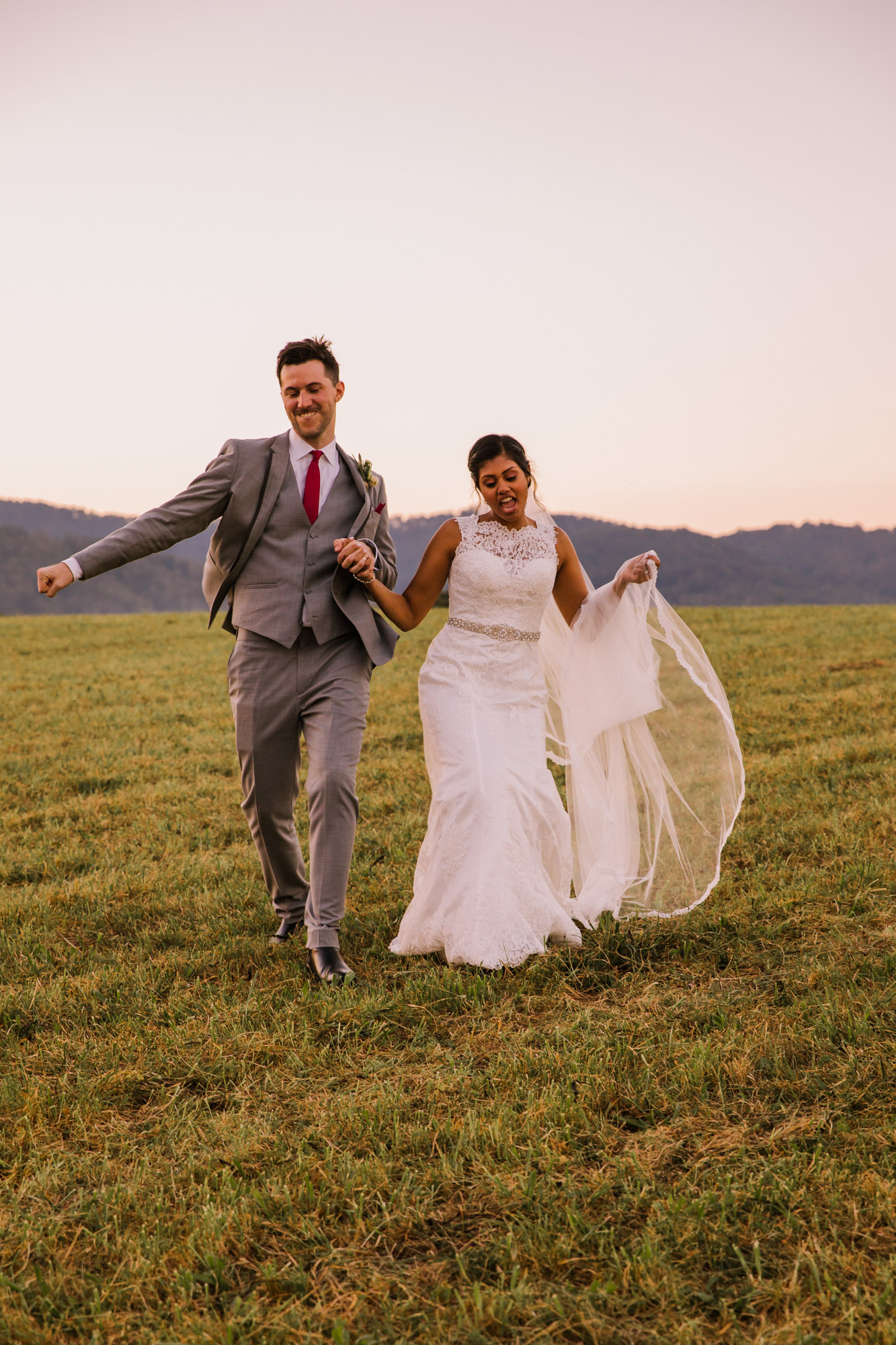 Waynesville NC Wedding Photography | Bride and Groom Grooving and Dancing in the Field
