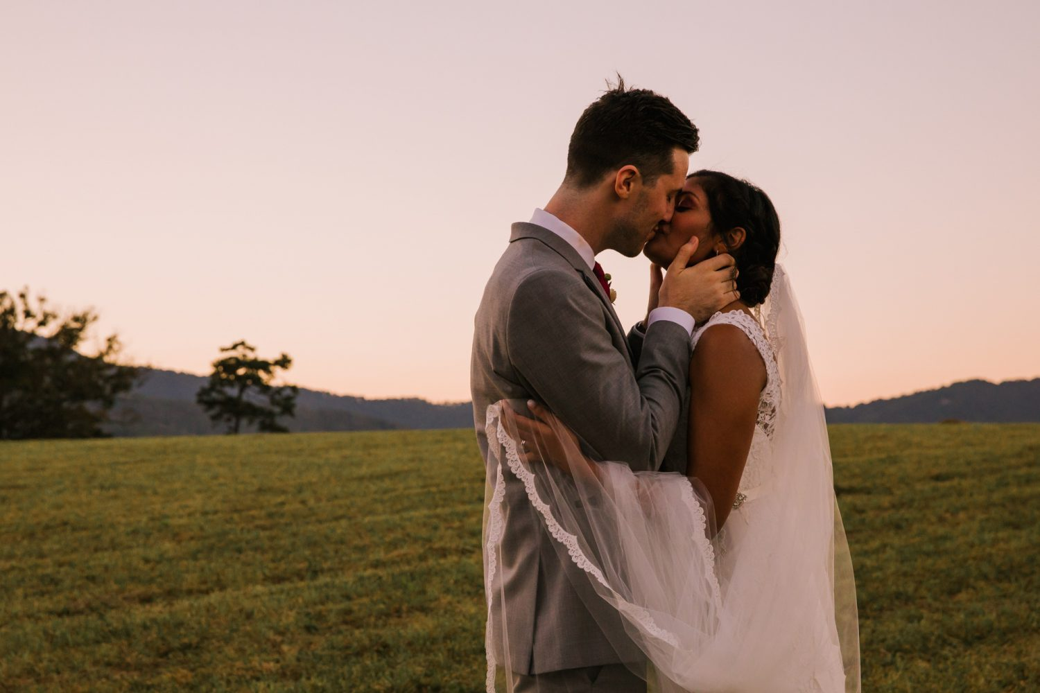 Waynesville NC Wedding Photography | Bride and Groom Kissing at Sunset