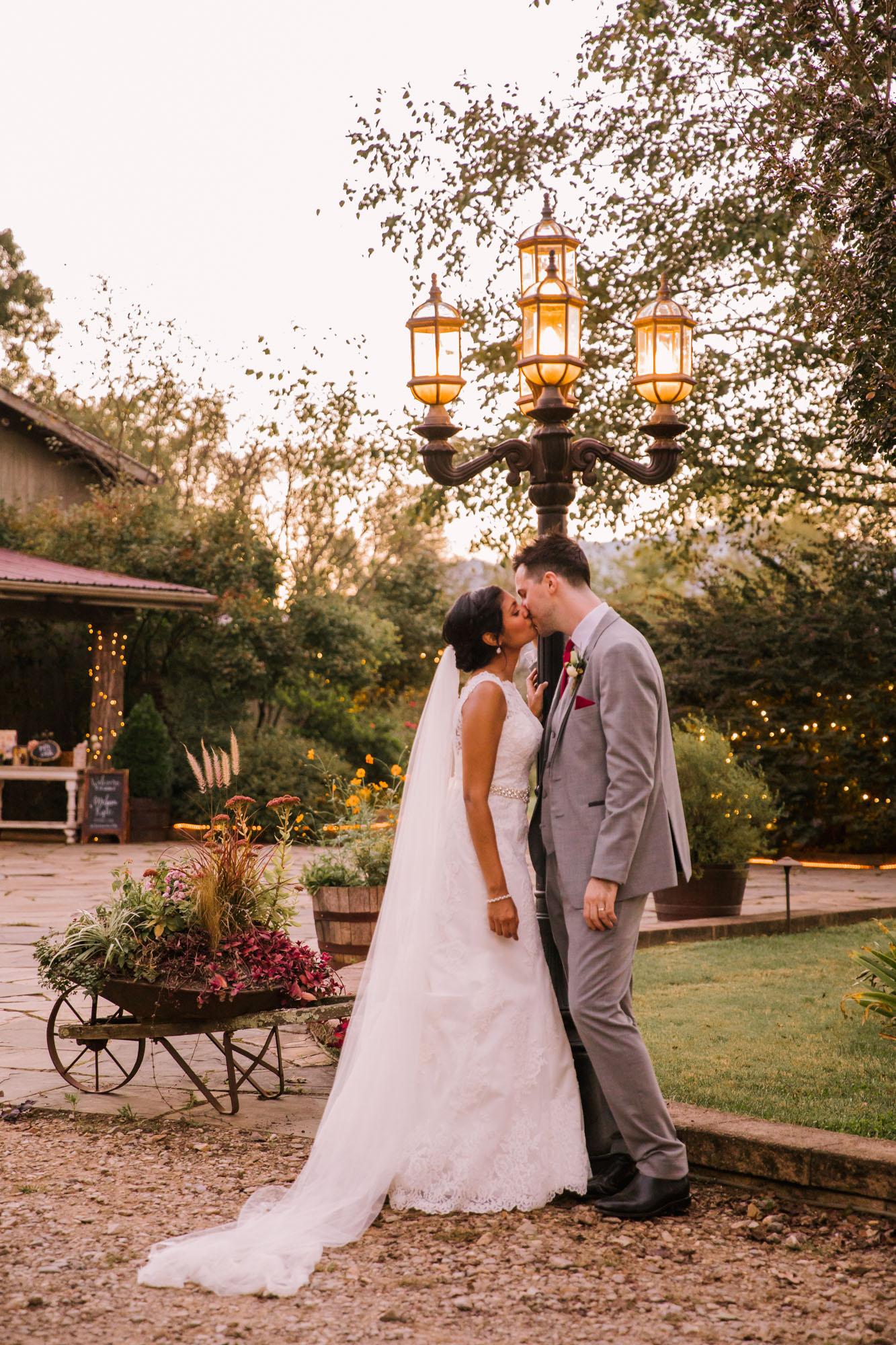 Waynesville NC Wedding Photography | Bride and Groom Kissing Under Lamppost