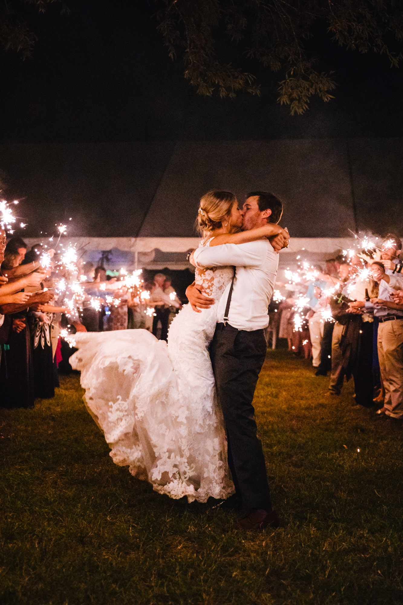 Waynesville, NC Wedding Photography | Bride and Groom Kissing at Wedding Reception Exit