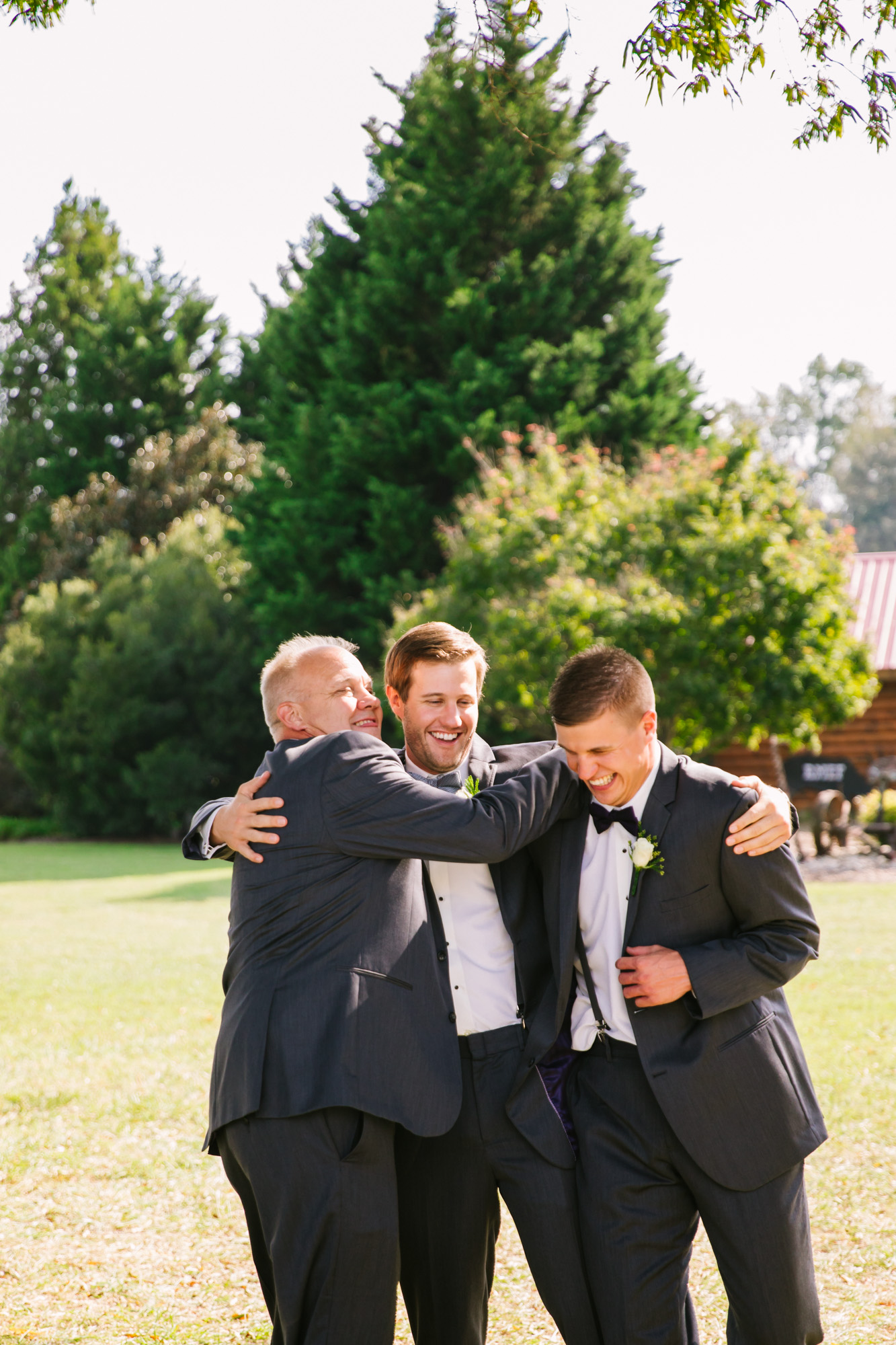 Waynesville, NC Wedding Photography | Groom Hugging Father and Brother