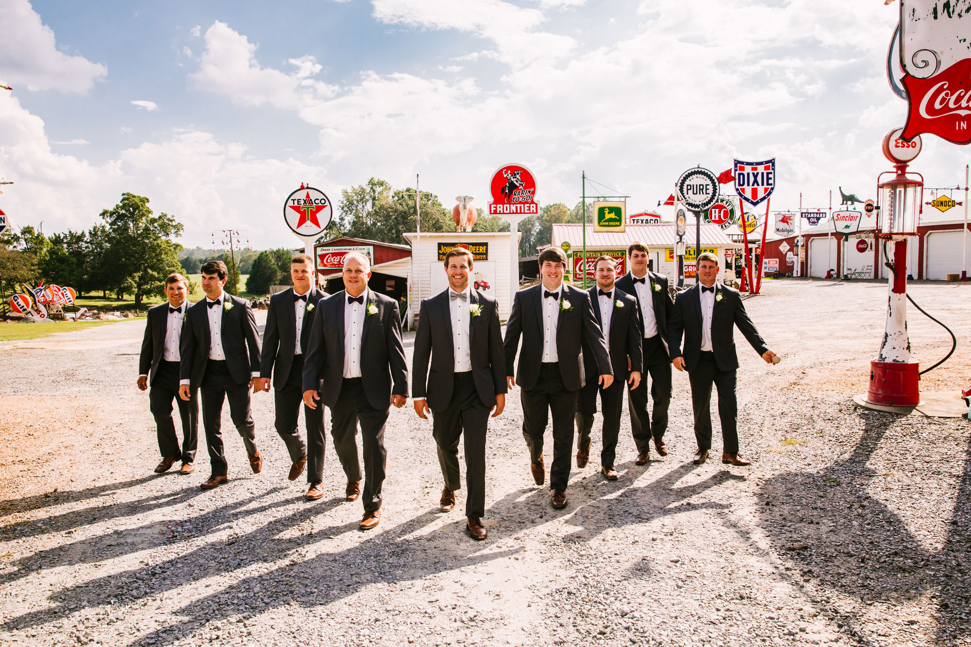 Waynesville, NC Wedding Photography | Groomsmen portrait in Vintage Gas Station Sign Collection
