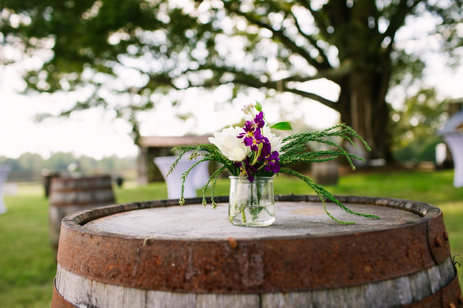 Waynesville, NC Wedding Photography | Wedding Reception mini bouquet on rustic barrel
