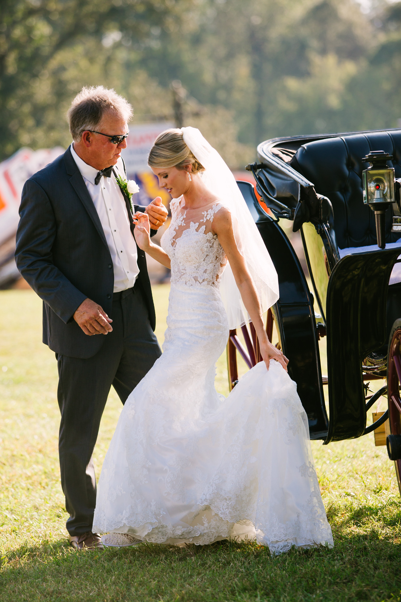 Waynesville, NC Wedding Photography | Bride Lifting Wedding Dress from Carriage