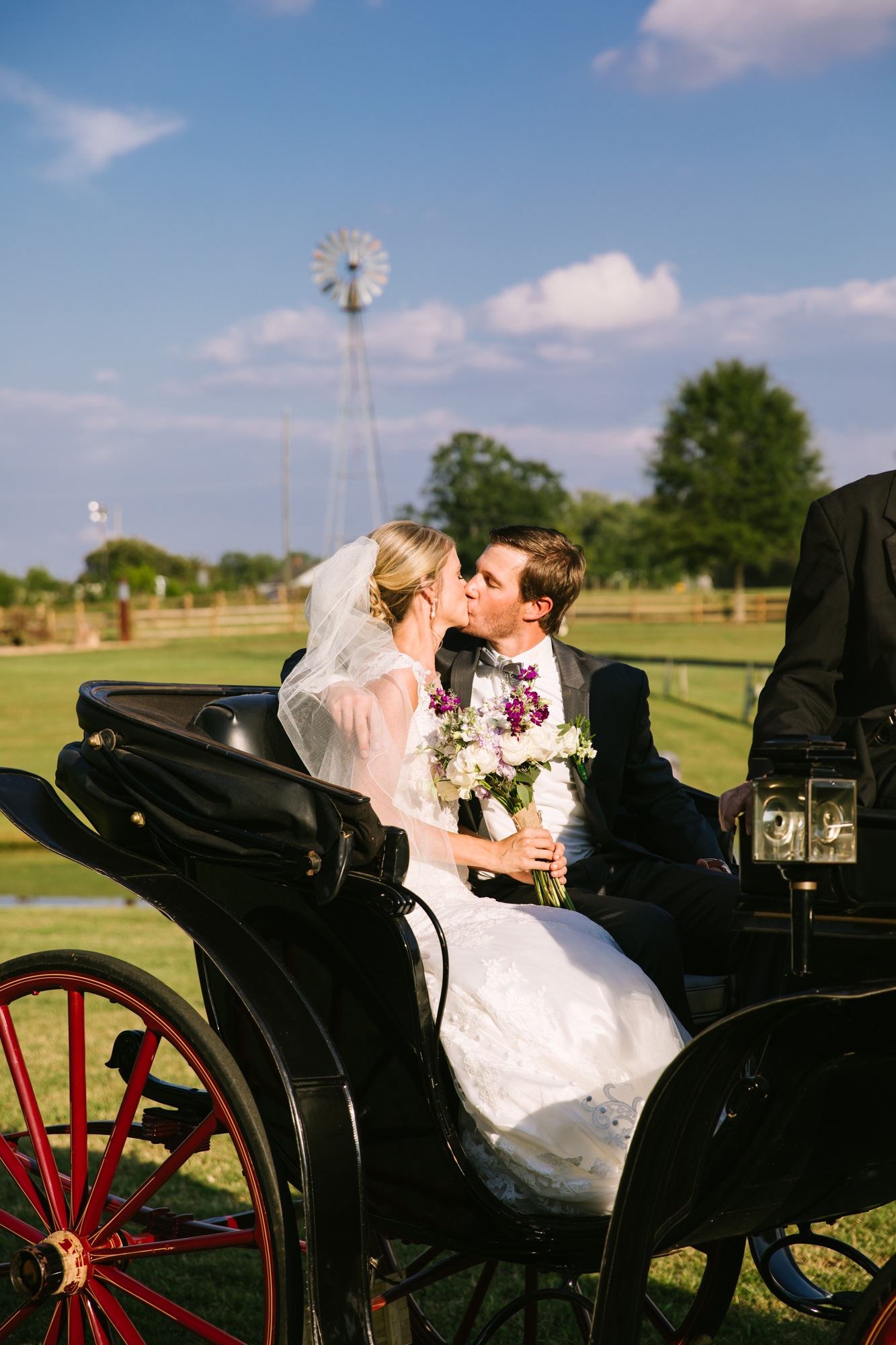 Waynesville, NC Wedding Photography | Bride and Groom Kissing in Horse Carriage