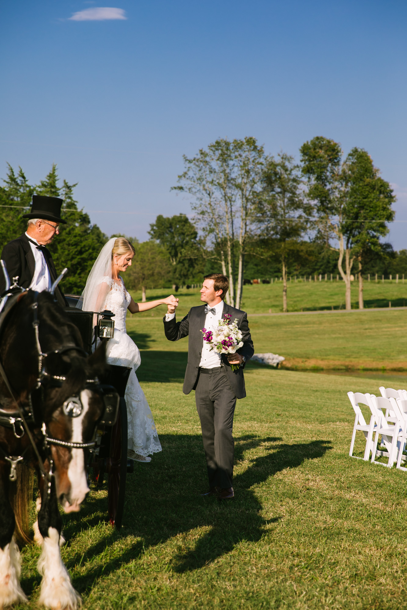 Waynesville, NC Wedding Photography | Groom Helps Bride off back of Horse Carriage