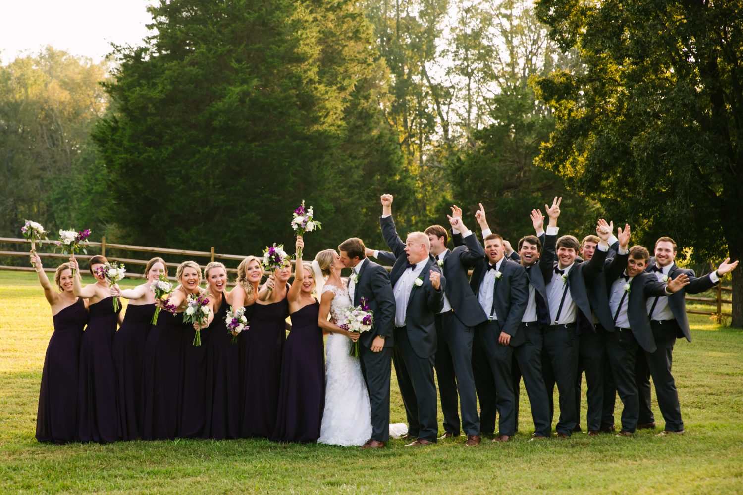 Waynesville, NC Wedding Photography | Bridal Party Celebrates a Kiss
