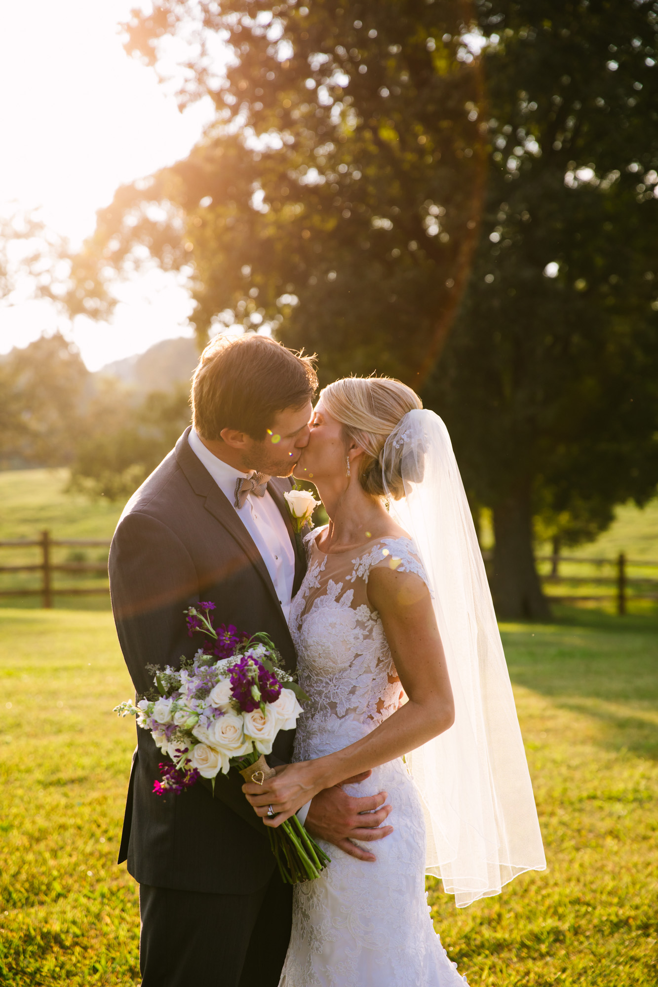 Waynesville, NC Wedding Photography | Bride and Groom Kissing Sun Flare
