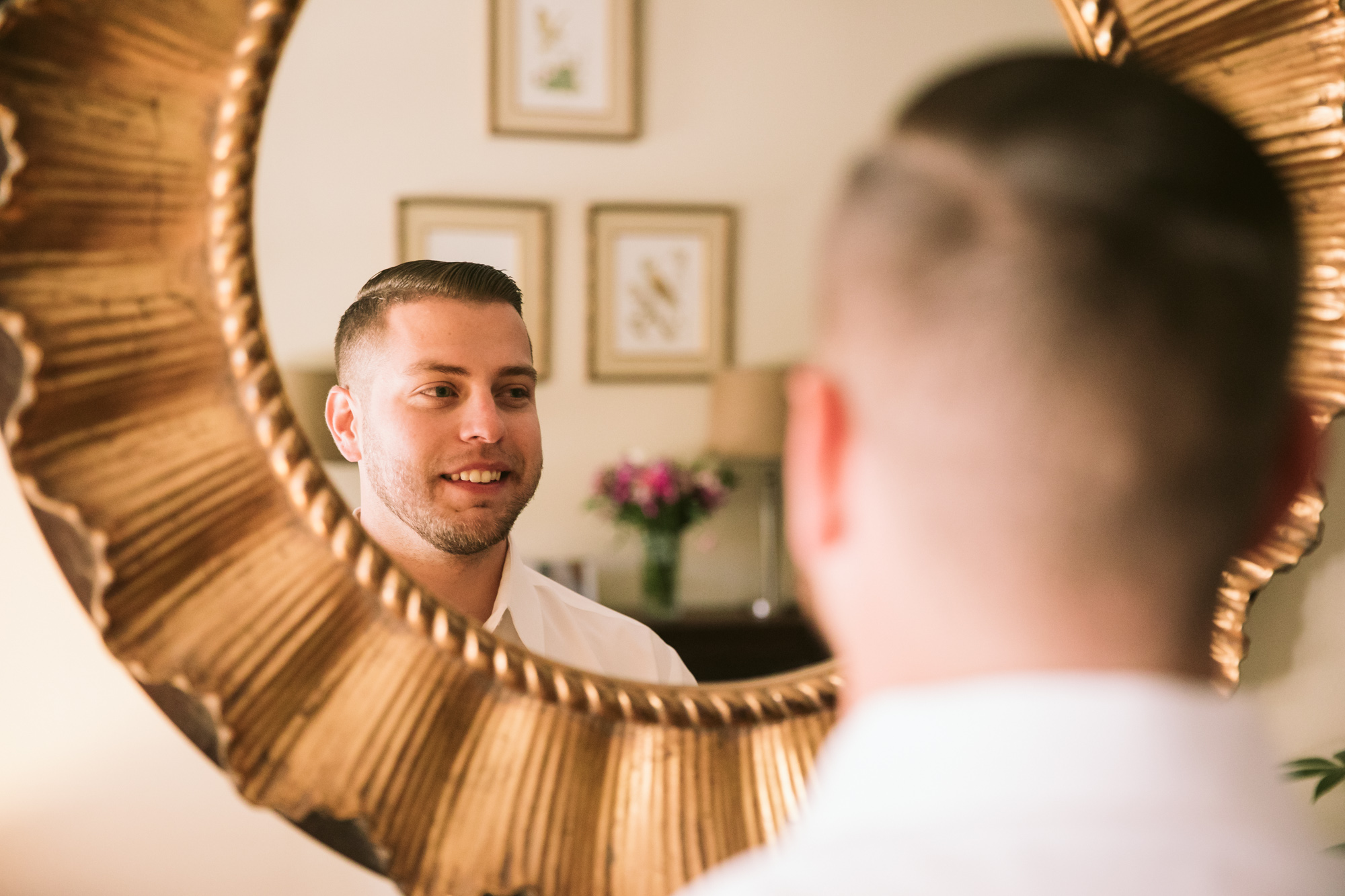 Waynesville NC Wedding Photography | Groom Smiling in the Mirror