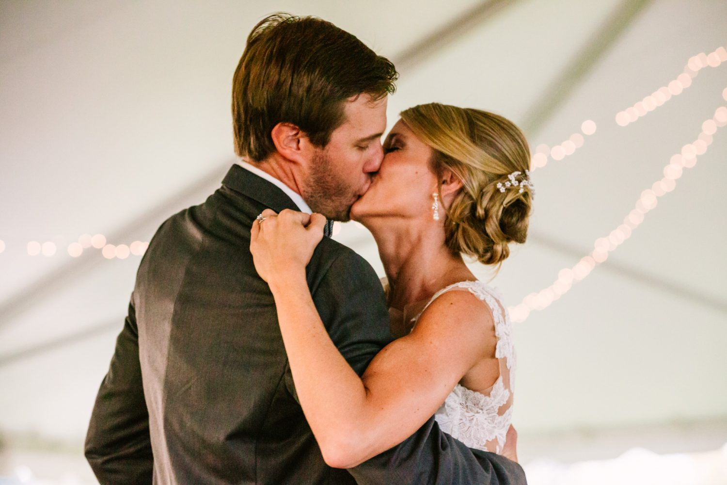 Waynesville, NC Wedding Photography | Bride and Groom Kissing Cafe Lights in Background