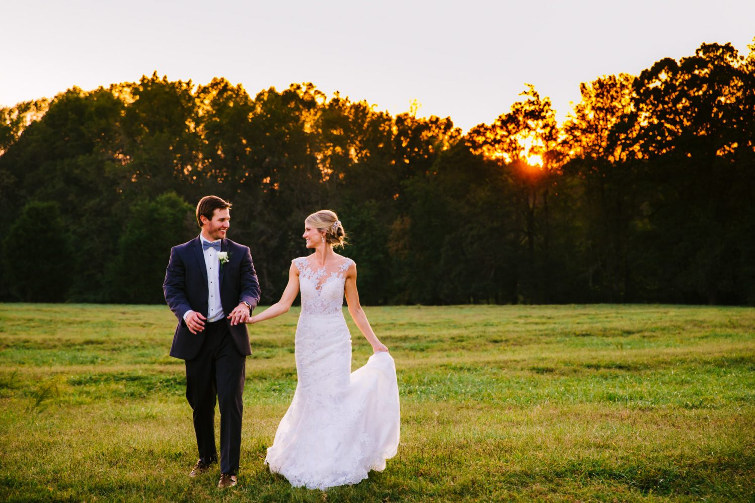 Waynesville, NC Wedding Photography | Bride and Groom Walking in the Field at Sunset